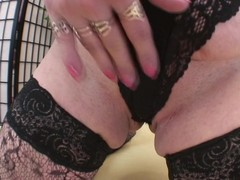 Generous titted mammy playing with a toy