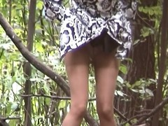 Candid girl in pantyhose was caught pissing in rub-down a catch wood