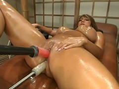 Oiled up dark Ava Devine jumps on a fucking machine