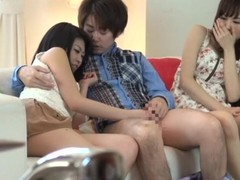 Two abstain Japanese girls have hot threesome sex on a sofa