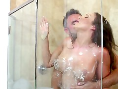 A busty brunette is penetrated while this babe is in the shower