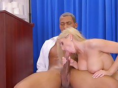 A blonde with big tits is sliding on a big hard dick