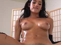 Oiled Chloe Amour sits on a big cock and rides it erotically